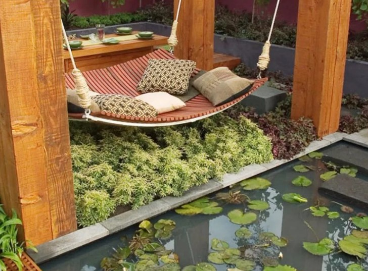 A minimalist fish pond with a hammock that adds to the beauty of the courtyard